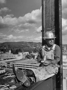Carpenter Chuck Haines Relaxing on Sixth Story I Beam, Lunching on a Ham and Cheese Sandwich by Alfred Eisenstaedt