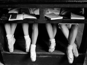 Close Up of Legs of Young Ballerinas in Toe Shoes under Desk at La Scala Ballet School by Alfred Eisenstaedt