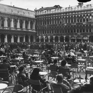 Crowd in Piazza San Marco. Tables at Cafe Florian in Foreground by Alfred Eisenstaedt