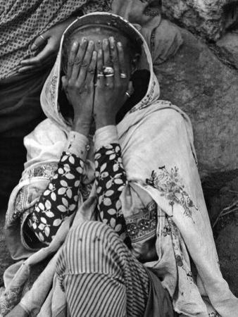 Ethiopian Woman Covering Her Face with Her Hands by Alfred Eisenstaedt