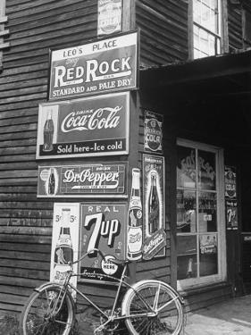Food Store Called Leo's Place Covered with Beverage Ads Incl. Coca Cola, 7 Up, Dr. Pepper and Pepsi by Alfred Eisenstaedt