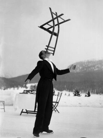 Head Waiter Rene Breguet Balancing Chair on Chin at Ice Rink of Grand Hotel by Alfred Eisenstaedt