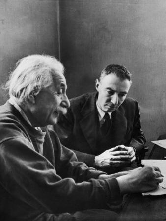 J. Robert Oppenheimer, Dir. of Institute of Advanced Study, Discussing with Dr. Albert Einstein