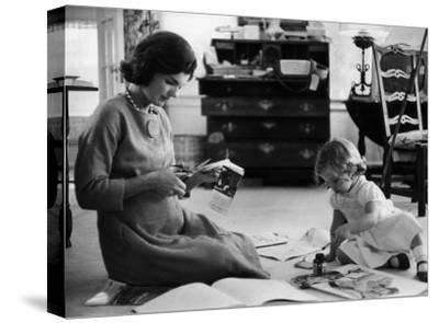 Jackie Kennedy, Wife of Sen, Cutting Out Newspaper Clippings Next to Open Scrapbook by Alfred Eisenstaedt