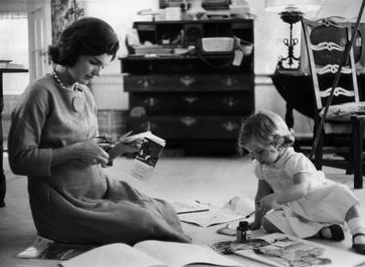 Jackie Kennedy, Wife of Sen, Cutting Out Newspaper Clippings Next to Open Scrapbook