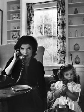 Jackie Kennedy, Wife of Senator John Kennedy, Talking on the Telephone as her daughter mimics her by Alfred Eisenstaedt