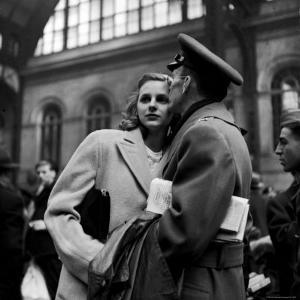 Lieut. John Hancock Spear Kissing His Bride, Ester, While Saying Goodbye in Penn Station by Alfred Eisenstaedt