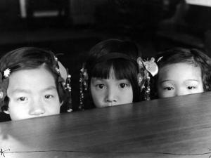 Little Girls Peeking over Rim of Table at California Chinese Mission School by Alfred Eisenstaedt