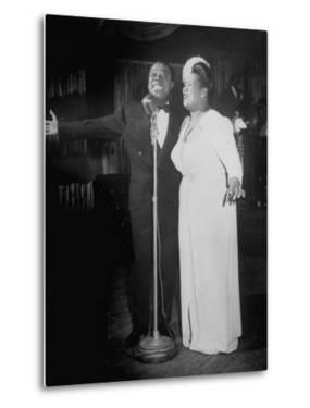 Louis Armstrong and Vocalist Performing in Floor Show at Cafe Zanzibar by Alfred Eisenstaedt