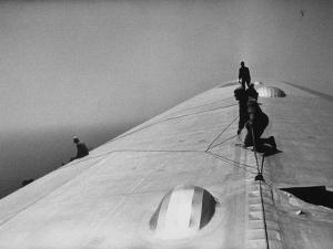 Maintenance Crewmen on Top of Graf Zeppelin repair damage caused Atlantic Ocean Storm during flight by Alfred Eisenstaedt