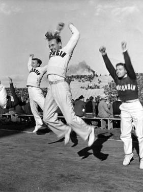 Male Cheerleaders in Action at Wisconsin-Marquette Football Game by Alfred Eisenstaedt