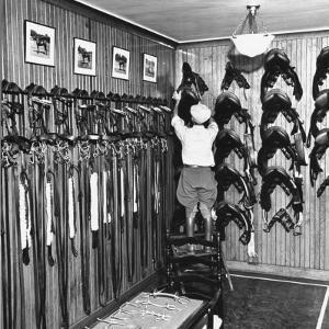 Man Checking Equipment Inside a Stable's Tack Room by Alfred Eisenstaedt