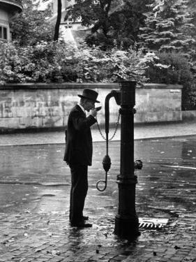 Man Drinking Water at Well Pump by Alfred Eisenstaedt