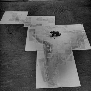 Man Works on Map of Latin and South America under Supervision of Political Geographer Isaiah Bowman by Alfred Eisenstaedt