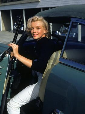 Marilyn Monroe Getting Out of a Car by Alfred Eisenstaedt