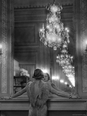 Model in Ostrich Feather Trimmed Gown Pausing to Regard Herself in Grand Mirror of Molyneux Atelier by Alfred Eisenstaedt