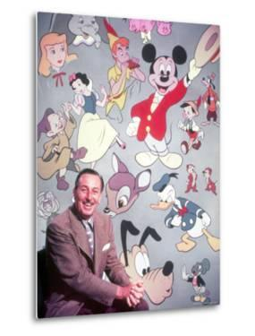 Movie Studio Head Walt Disney Sitting in Front of Backdrop Filled with Disney Creations by Alfred Eisenstaedt