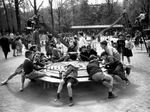 Parisian Children Riding Merry Go Round in a Playground by Alfred Eisenstaedt