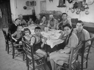 Portrait of a Family of Tuscan Tennat Farmers Sitting around Dinner Table by Alfred Eisenstaedt