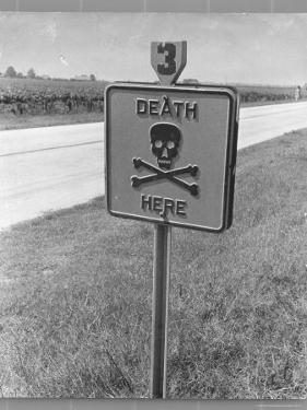 "Skull and Crossbones Surrounded by the Words ""Death Here"" marking fatal car accident by Alfred Eisenstaedt"