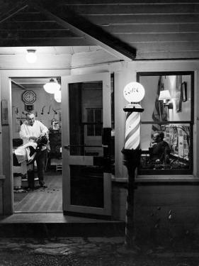 Small Town Barber Grover Cleveland Kohl Working in His Shop at Night by Alfred Eisenstaedt