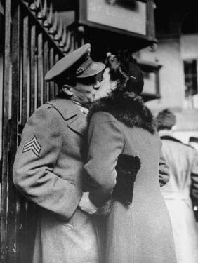 Soldier Giving a Farewell Kiss to His Lady Friend at Penn Station before Shipping Out by Alfred Eisenstaedt