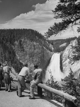 Tourists Viewing Waterfall in Yellowstone National Park by Alfred Eisenstaedt