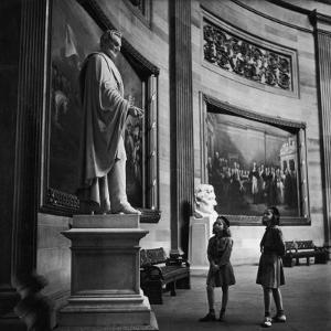Two Girl Scouts Looking Up at Marble Statue of Abraham Lincoln, Rotunda of the Capitol Building by Alfred Eisenstaedt