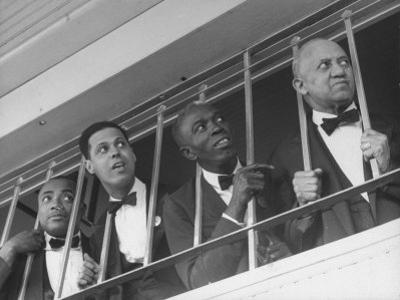Waiters at the Churchill Downs Bar Watching the Derby Horses Coming Down the Stretch by Alfred Eisenstaedt