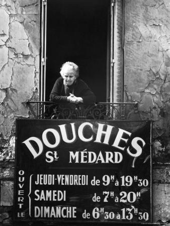 Woman in Window of Public Baths by Alfred Eisenstaedt