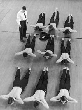 Yale University Swimmers Do Strengthening Exercises on Floor of Gym by Alfred Eisenstaedt