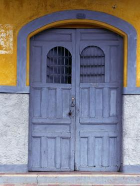 A Smokey Grey Wooden Door of a Painted Colonial House, Granada,Granada, Nicaragua by Alfredo Maiquez