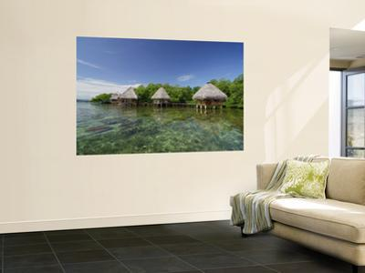 Cabins on the Tropical Waters of Coral Key, Bastimentos Marine Park by Alfredo Maiquez