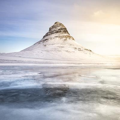 Europe, Iceland, Kirkjufell - The Iconic Mountain Of Iceland Reflecting On A Frozen Lake