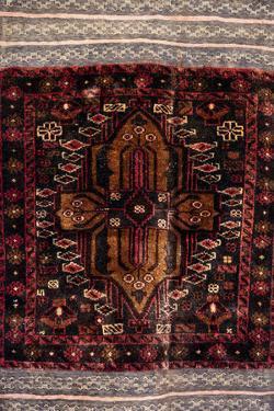 Africa, Tanzania, Zanzibar, Stone Town. Close-up of hand-made carpet. by Alida Latham
