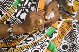 Africa, West Africa, Ghana, Kumasi. Close-up of cheif's jewelry and dress by Alida Latham