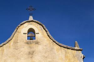 Italy, Sardinia, Gavoi. the Bell and Cross of an Old Church, Backed by a Blue Sky by Alida Latham