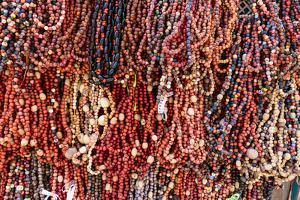 South America, Brazil, Salvador. Close-up of beads made of acai berries. by Alida Latham