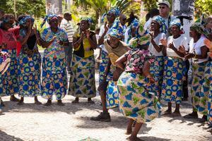 Women and Men Dancing in Traditional Dress, Benguela, Angola by Alida Latham