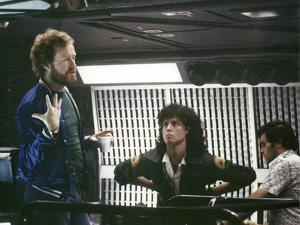 Alien, 1979 directed by Ridley Scott On the set; the director (Ridley Scott) with Sigourney Weaver
