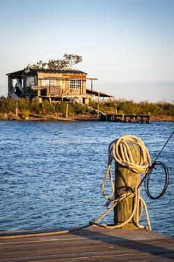 Dock and House across Bayou Petit Caillou, Cocodrie, Louisiana, USA by Alison Jones
