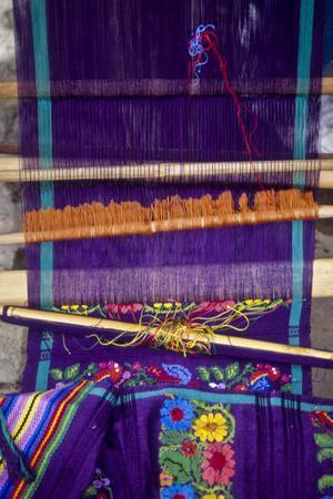 Guatemala: San Antonio, weaving on backstrap loom, July