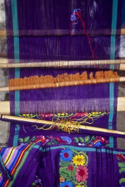 Guatemala: San Antonio, weaving on backstrap loom, July by Alison Jones