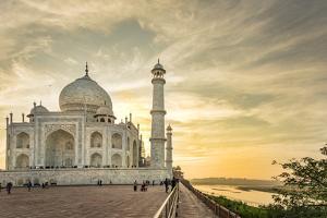 India, Uttar Pradesh. Agra. Taj Mahal tomb and minarets on the Yamuna River at sunset by Alison Jones