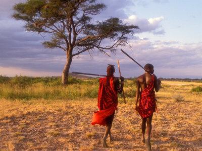 Two Maasai Morans Walking with Spears at Sunset, Amboseli National Park, Kenya