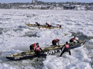 Ice Canoe Races on the St. Lawrence River During Winter Carnival, Quebec, Canada by Alison Wright