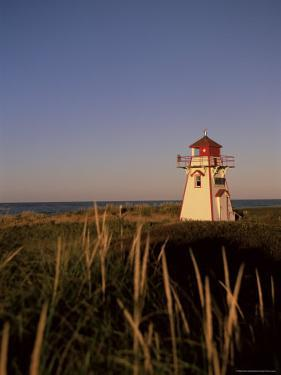 Lighthouse at Cavendish Beach, Prince Edward Island, Canada, North America by Alison Wright