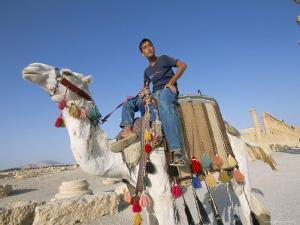 Teenage Boy on Camel in Front of the Great Colonnade, Palmyra, Syria, Middle East by Alison Wright