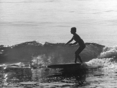 16 Yr. Old Surfer Kathy Kohner Riding a Wave