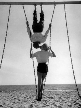 Acrobat and Actor, Russ Tamblyn on the Beach with Movie Actress Venetia Stevenson by Allan Grant